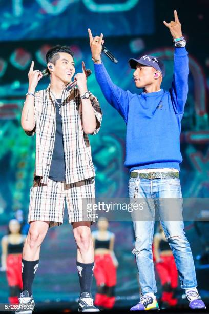 Singers Kris Wu and Pharrell Williams perform on the stage during 2017 Alibaba Singles' Day Global Shopping Festival gala at MercedesBenz Arena on...