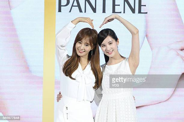 Singers Kwon Yuri and Seohyun of Girls' Generation attend a commercial activity of Seohyun on August 4 2016 in Beijing China