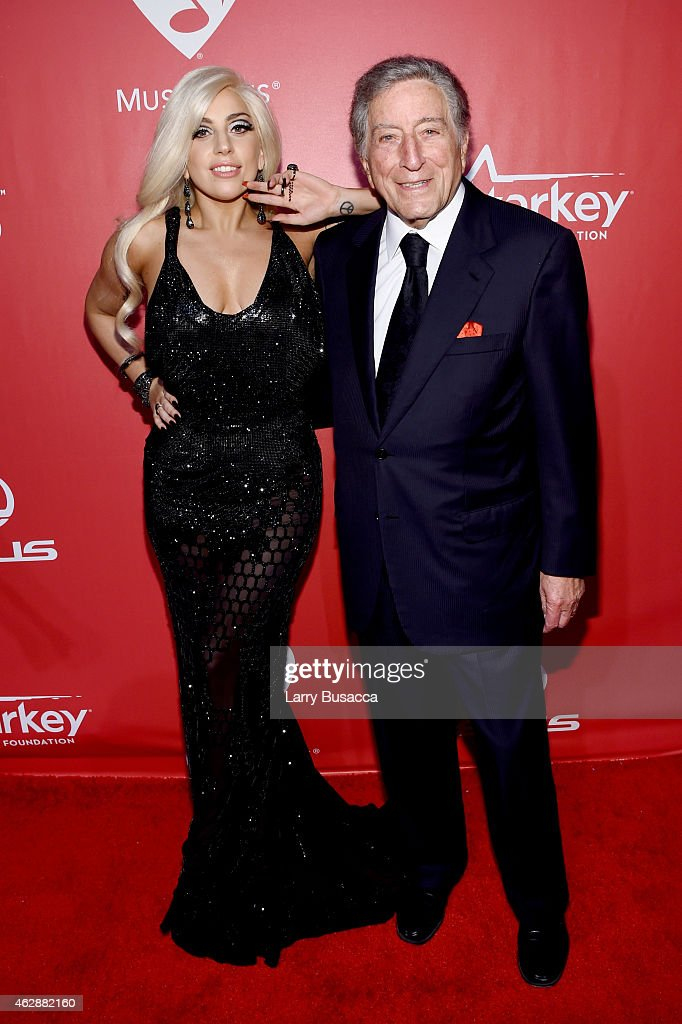 Singers Lady Gaga (L) and Tony Bennett attend the 25th anniversary MusiCares 2015 Person Of The Year Gala honoring Bob Dylan at the Los Angeles Convention Center on February 6, 2015 in Los Angeles, California. The annual benefit raises critical funds for MusiCares' Emergency Financial Assistance and Addiction Recovery programs. For more information visit musicares.org.