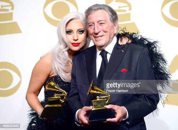 Singers Lady Gaga and Tony Bennett winners of Best Traditional Pop Vocal Album for 'Cheek to Cheek' pose in the press room during The 57th Annual...