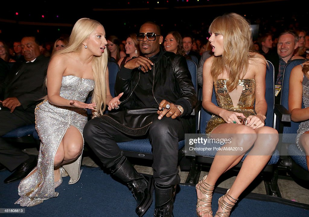 Singers <a gi-track='captionPersonalityLinkClicked' href=/galleries/search?phrase=Lady+Gaga&family=editorial&specificpeople=4456754 ng-click='$event.stopPropagation()'>Lady Gaga</a>, <a gi-track='captionPersonalityLinkClicked' href=/galleries/search?phrase=R.+Kelly&family=editorial&specificpeople=204472 ng-click='$event.stopPropagation()'>R. Kelly</a> and <a gi-track='captionPersonalityLinkClicked' href=/galleries/search?phrase=Taylor+Swift&family=editorial&specificpeople=619504 ng-click='$event.stopPropagation()'>Taylor Swift</a> attend the 2013 American Music Awards at Nokia Theatre L.A. Live on November 24, 2013 in Los Angeles, California.