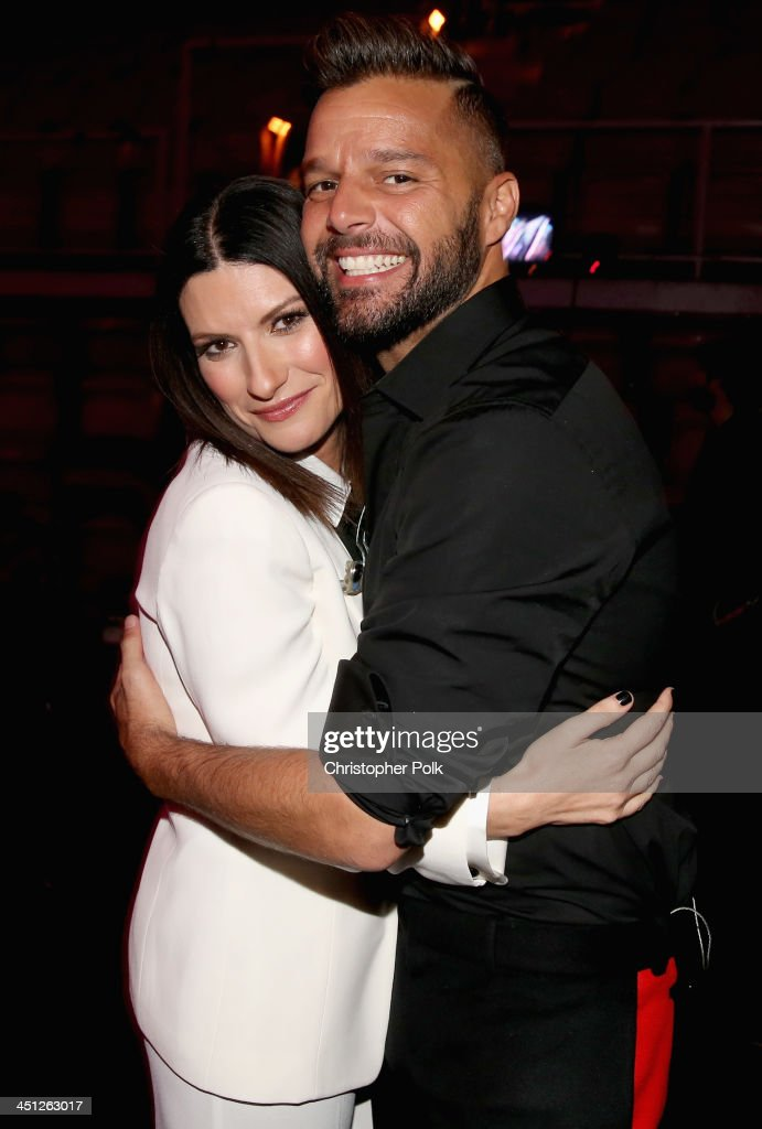 Singers <a gi-track='captionPersonalityLinkClicked' href=/galleries/search?phrase=Laura+Pausini&family=editorial&specificpeople=616401 ng-click='$event.stopPropagation()'>Laura Pausini</a> (L) and <a gi-track='captionPersonalityLinkClicked' href=/galleries/search?phrase=Ricky+Martin&family=editorial&specificpeople=160450 ng-click='$event.stopPropagation()'>Ricky Martin</a> pose backstage during the 14th Annual Latin GRAMMY Awards held at the Mandalay Bay Events Center on November 21, 2013 in Las Vegas, Nevada.