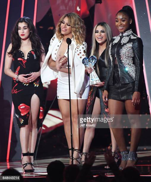 Singers Lauren Jauregui Dinah Jane Ally Brooke and Normani Kordei of Fifth Harmony accept the Best Fan Army award onstage from host Ryan Seacrest at...