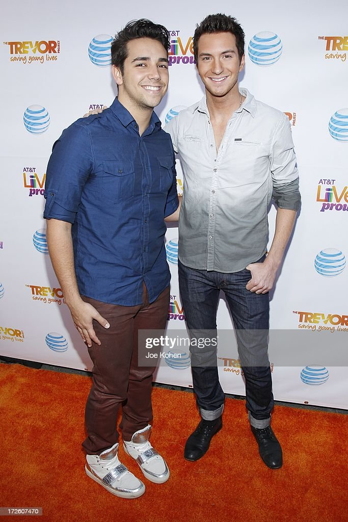 Singers Lazaro Arbos (L) and Paul Jolley attend Adam Lambert Performance And Check Donation Presentation To The Trevor Project For 'Live Proud' Campaign at Playhouse Hollywood on July 3, 2013 in Los Angeles, California.