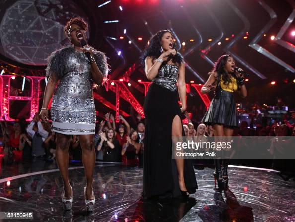 Singers Ledisi Jordin Sparks and Melanie Fiona perform onstage during 'VH1 Divas' 2012 at The Shrine Auditorium on December 16 2012 in Los Angeles...
