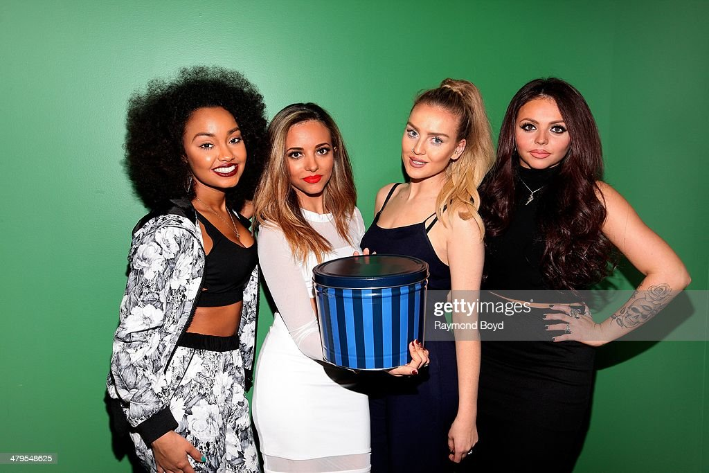 Singers LeighAnne Pinnock Jade Thirlwall Perrie Edwards and Jesy Nelson of British girl group Little Mix poses for photos in the 1035 KISS FM 'Sprite...