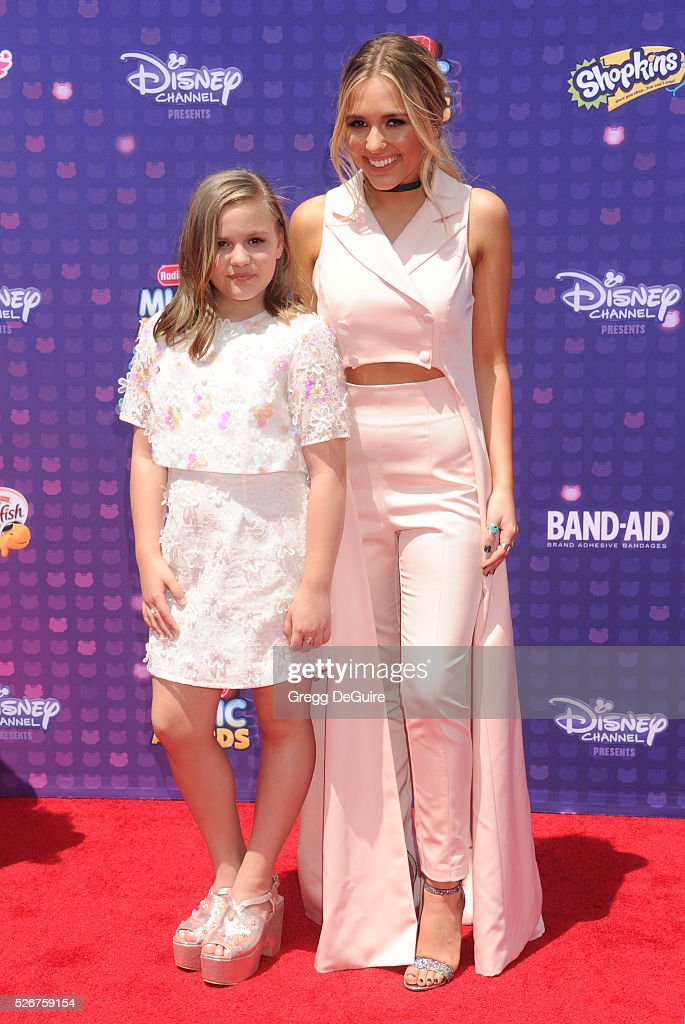 Singers Lennon Stella and Maisy Stella of musical duo Lennon and Maisy arrive at the 2016 Radio Disney Music Awards at Microsoft Theater on April 30, 2016 in Los Angeles, California.
