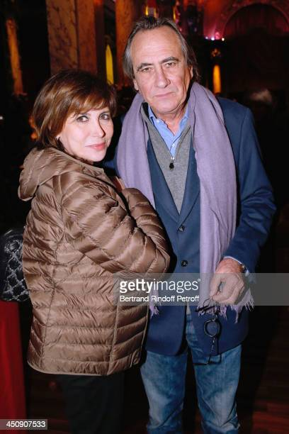 Singers Liane Foly and Philippe Lavil attend Coca Cola Christmas Father Waxwork Unveiling Event at Musee Grevin on November 20 2013 in Paris France