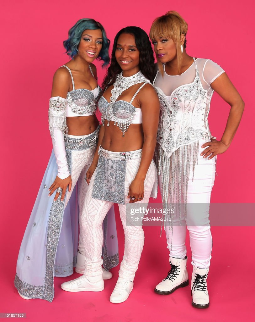 Singers <a gi-track='captionPersonalityLinkClicked' href=/galleries/search?phrase=Lil+Mama&family=editorial&specificpeople=4231669 ng-click='$event.stopPropagation()'>Lil Mama</a> and TLC's Rozonda 'Chilli' Thomas and Tionne '<a gi-track='captionPersonalityLinkClicked' href=/galleries/search?phrase=T-Boz&family=editorial&specificpeople=715877 ng-click='$event.stopPropagation()'>T-Boz</a>' Watkins pose for a portrait during the 2013 American Music Awards at Nokia Theatre L.A. Live on November 24, 2013 in Los Angeles, California.