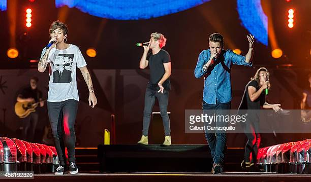 Singers Louis Tomlinson Niall Horan Liam Payne and Harry Styles perform during On the Road Again Tour 2015 at Lincoln Financial Field on September 1...