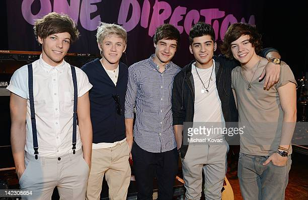 Singers Louis Tomlinson Niall Horan Liam Payne Zayn Malik and Harry Styles of One Direction backstage at VEVO LIFT Presents One Direction Live At The...