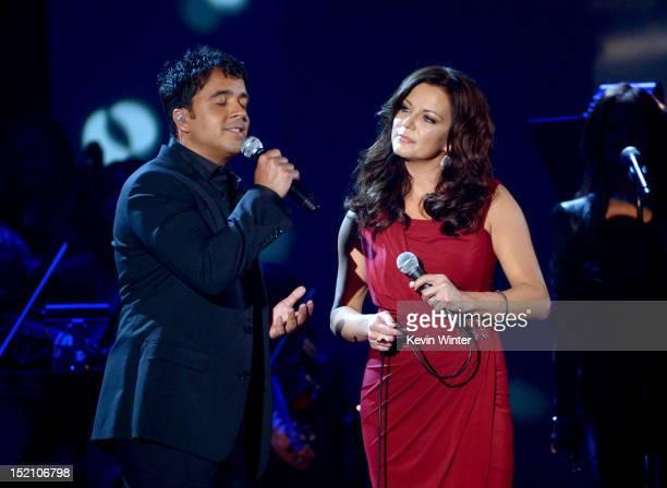 Singers Luis Fonsi and Martina McBride perform onstage at the 2012 NCLR ALMA Awards at Pasadena Civic Auditorium on September 16 2012 in Pasadena...