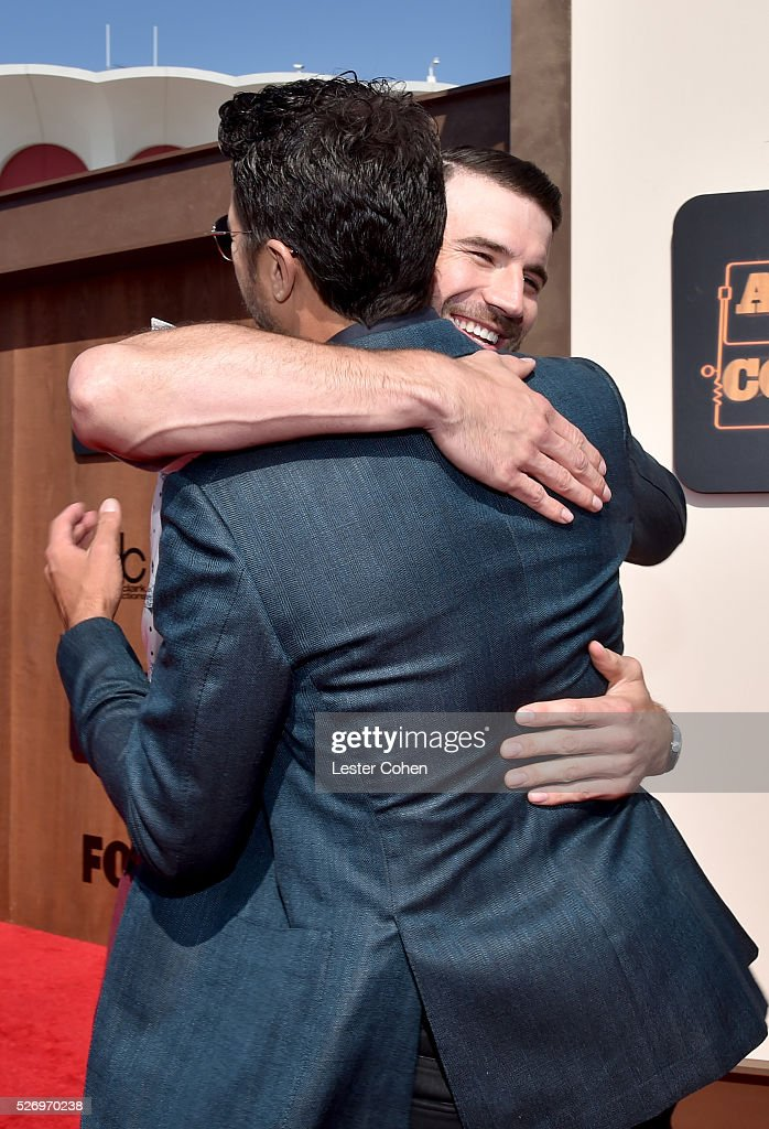 Singers Luke Bryan (L) and Sam Hunt embrace during the 2016 American Country Countdown Awards at The Forum on May 1, 2016 in Inglewood, California.