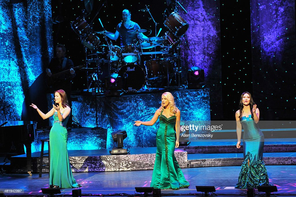 Singers Lynn Hilary, Susan McFadden, Mairead Carlin of Celtic Woman perform during 'The Emerald Tour' concert at Segerstrom Center For The Arts on April 1, 2014 in Costa Mesa, California.