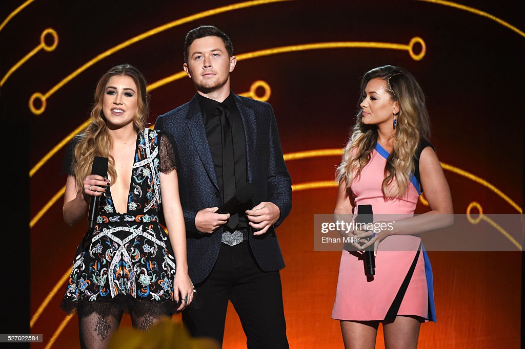 Singers Maddie Marlow, <a gi-track='captionPersonalityLinkClicked' href=/galleries/search?phrase=Scotty+McCreery&family=editorial&specificpeople=7520936 ng-click='$event.stopPropagation()'>Scotty McCreery</a> and Tae Dye speak onstage during the 2016 American Country Countdown Awards at The Forum on May 1, 2016 in Inglewood, California.