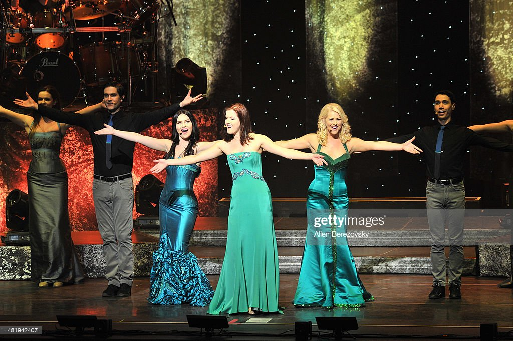 Singers Mairead Carlin, Lynn Hilary and Susan McFadden of Celtic Woman perform during 'The Emerald Tour' concert at Segerstrom Center For The Arts on April 1, 2014 in Costa Mesa, California.
