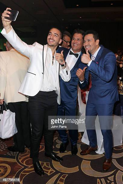 Singers Maluma Carlos Vives and Victor Manuelle take a selfie at the 2015 Latin GRAMMY Person of the Year honoring Roberto Carlos at the Mandalay Bay...