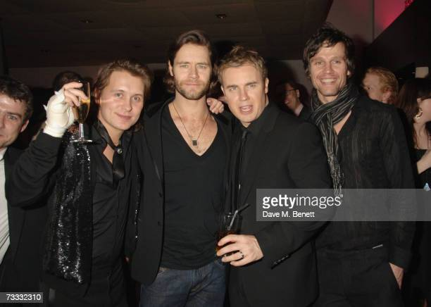 Singers Mark Owen Howard Donald Gary Barlow and Jason Orange from Take That pose at the Universal / Island Records BRITS after party at Mocoto...