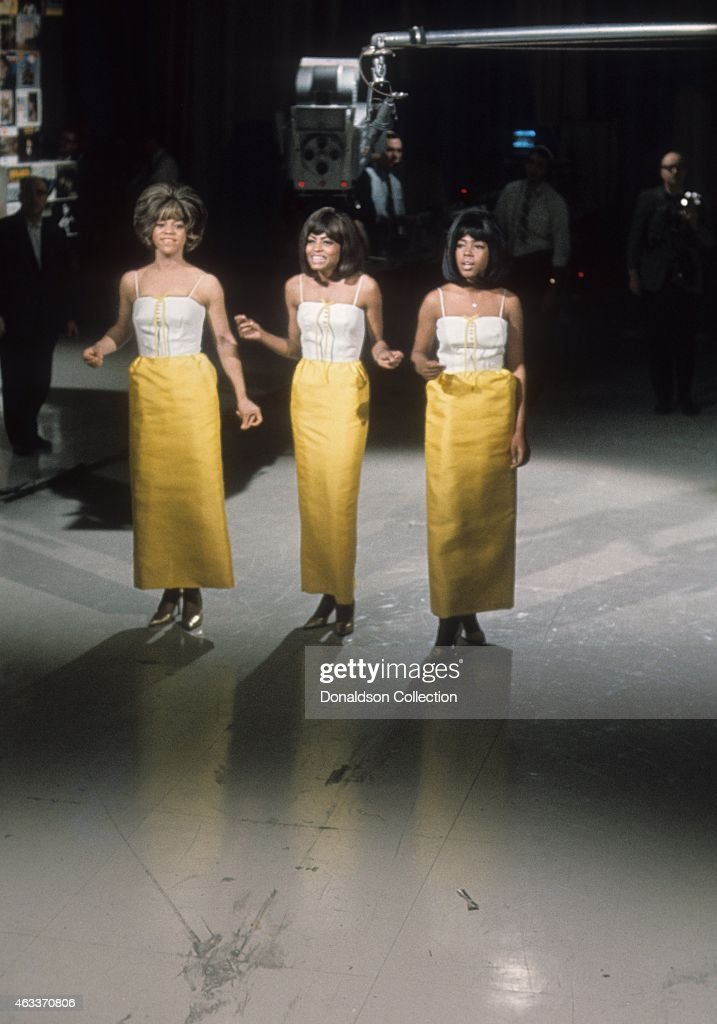 Singers Mary Wilson Florence Ballard and Diana Ross of the R and B Group 'The Supremes' perform on the TV show Hullabaloo on May 11 1965 in New York...