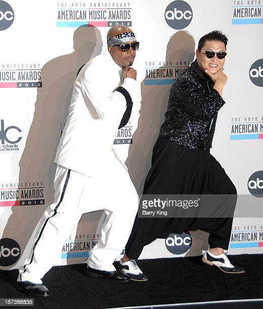 Singers MC Hammer and Psy pose in the press room at the 40th American Music Awards at Nokia Theatre LA Live on November 18 2012 in Los Angeles...