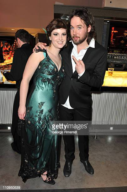 Singers Meaghan Smith and Kevin Drew of Broken Social Scene pose backstage in the eTalk Lounge during the 2011 Juno Awards at the Air Canada Centre...