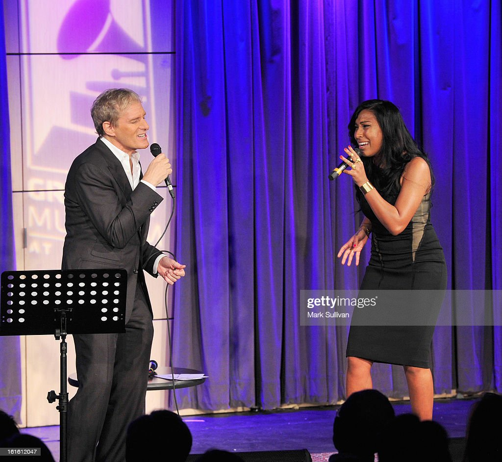 Singers Michael Bolton (L) and Melanie Fiona perform during An Evening With Michael Bolton at The GRAMMY Museum on February 12, 2013 in Los Angeles, California.