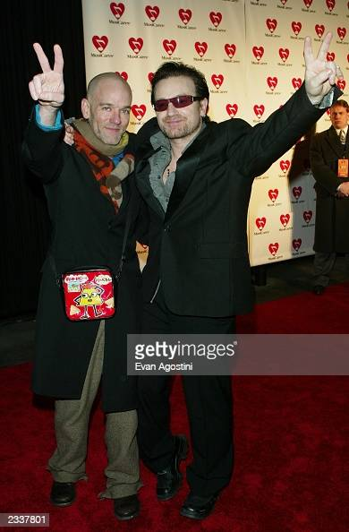 Singers Michael Stipe and Bono arrive to the 13th Annual MusiCares Person Of The Year tribute at the Marriott Marquis February 21 2003 in New York...