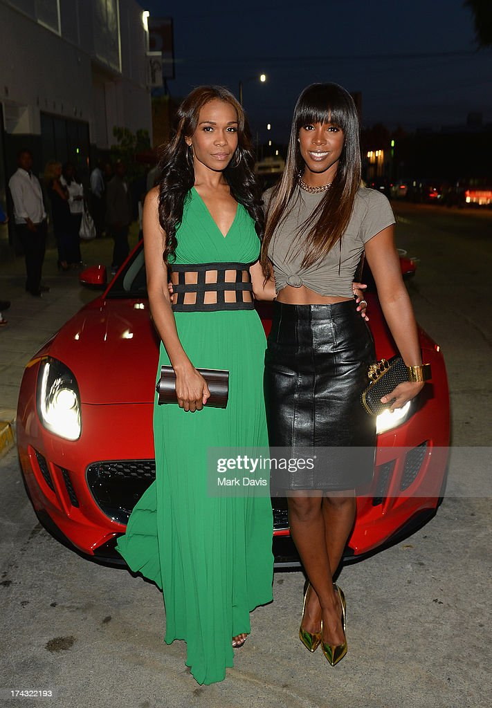 Singers Michelle Williams (L) and Kelly Rowland pose at the 'Jaguar and Gilt celebrate #MyTurnToJag' held at Siren Studios on July 23, 2013 in Hollywood, California.