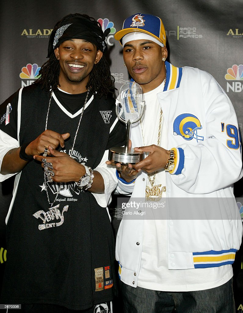 Singers Murphy Lee (L) and Nelly backstage at The 2003 Radio Music Awards at the Aladdin Casino Resort October 27, 2003 in Las Vegas, Nevada.