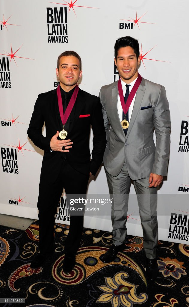 Singers Nacho (L) and Chino arrive at the BMI;s 20th Annual Latin Music Awards at the Bellagio on March 21, 2013 in Las Vegas, Nevada.