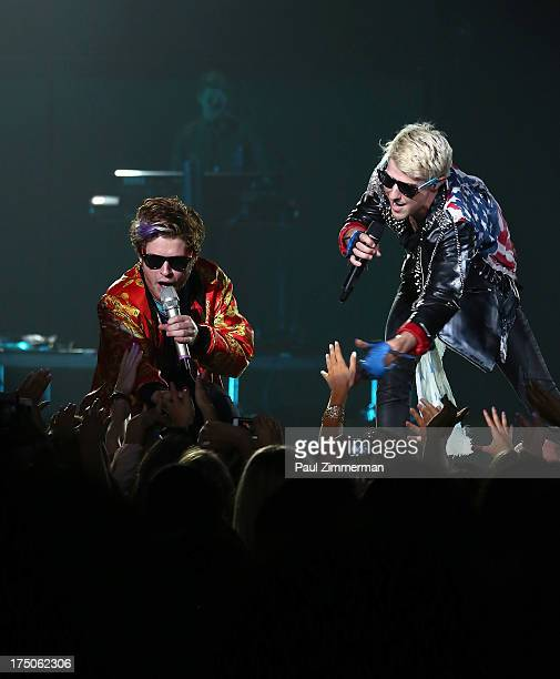 Singers Nash Overstreet and Ryan Follese of band Hot Chelle Rae perform at the Prudential Center on July 30 2013 in Newark New Jersey