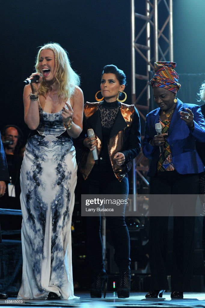 Singers Natasha Bedingfield and Nelly Furtado perform onstage at the One World Concert at Syracuse University on October 9 2012 in Syracuse New York