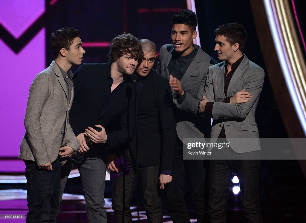 Singers Nathan Sykes, Jay McGuiness, Max George, Siva Kaneswaran, and Tom Parker of The Wanted accept the Favorite Breakout Artist award onstage at the 39th Annual People's Choice Awards at Nokia Theatre L.A. Live on January 9, 2013 in Los Angeles, California.
