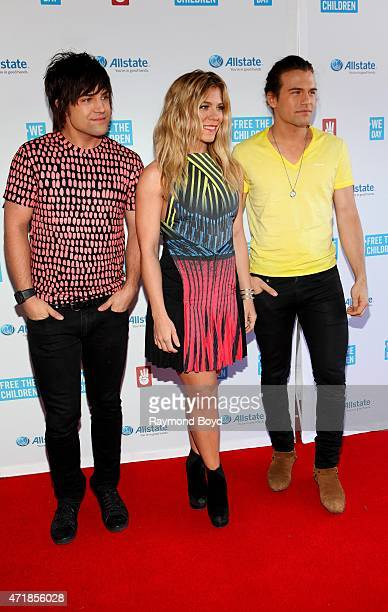Singers Neil Perry Kimberly Perry and Reid Perry from the group The Band Perry poses for photos on the red carpet during 'We Day' at the Allstate...