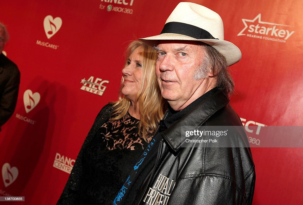 Singers Neil Young (R) and Pegi Young arrive at The 2012 MusiCares Person of The Year Gala Honoring Paul McCartney at Los Angeles Convention Center on February 10, 2012 in Los Angeles, California.
