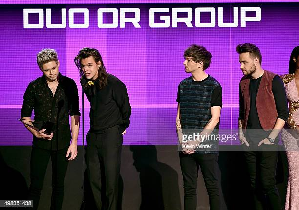 Singers Niall Horan Harry Styles Louis Tomlinson and Liam Payne of One Direction accept Favorite Pop/Rock Band/Duo/Group award onstage during the...