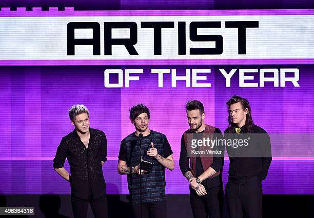 Singers Niall Horan Louis Tomlinson Liam Payne and Harry Styles of One Direction accept Artist of the Year award onstage during the 2015 American...