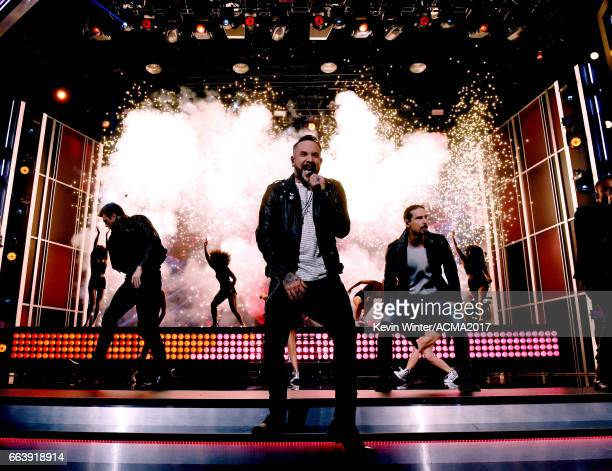 Singers Nick Carter AJ McLean and Kevin Richardson of Backstreet Boys perform onstage during the 52nd Academy of Country Music Awards at TMobile...