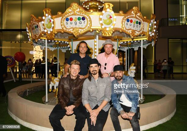 Singers Nick Carter Howie Dorough Kevin Richardson Brian Littrell and AJ McLean of the Backstreet Boys attend the grand opening of Sugar Factory...