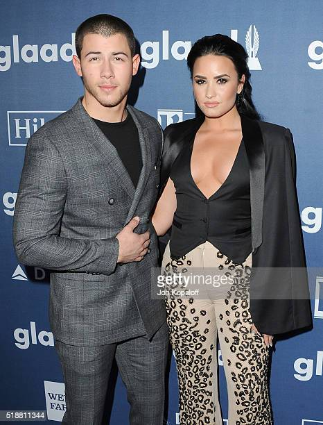 Singers Nick Jonas and Demi Lovato arrive at the 27th Annual GLAAD Media Awards at The Beverly Hilton Hotel on April 2 2016 in Beverly Hills...