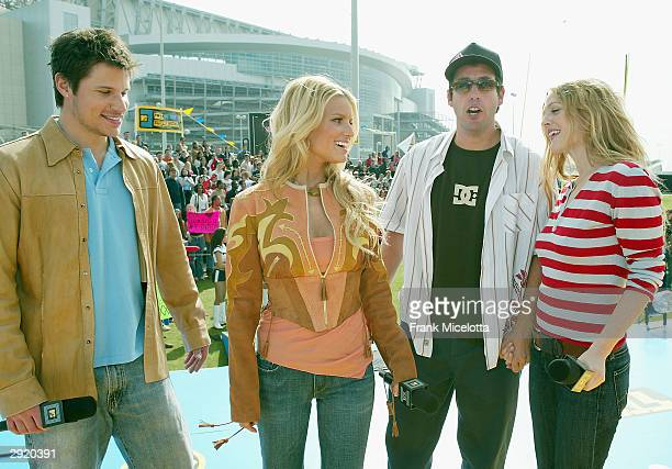 Singers Nick Lachey and wife Jessica Simpson pose with actors Adam Sandler and Drew Barrymore during the MTV TRL Super Bowl edition at Reliant Park...