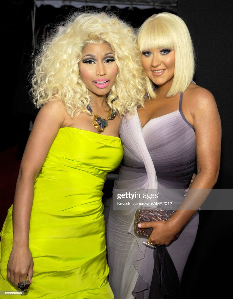 Singers Nicki Minaj (L) and Christina Aguilera attend the 40th American Music Awards held at Nokia Theatre L.A. Live on November 18, 2012 in Los Angeles, California.