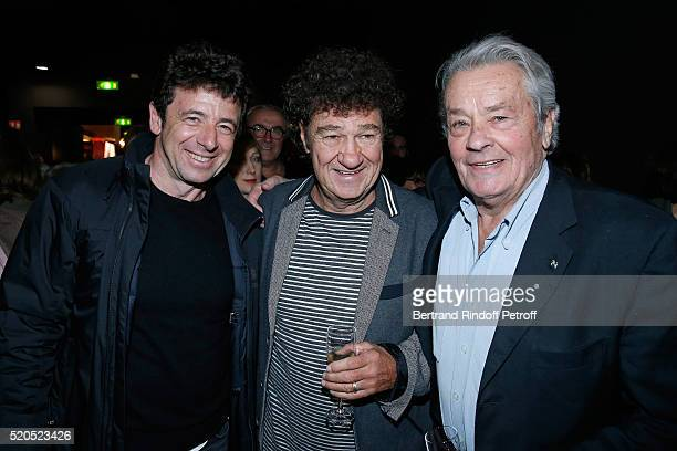 Singers Patrick Bruel Robert Charlebois and actor Alain Delon pose after the Robert Charlebois '50 ans 50 chansons' Concert at Bobino on April 11...