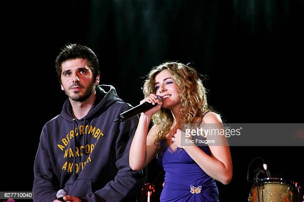 Singers Patrick Fiori and Julie Zenatti perform on stage at the launching of the new TV channels 'M6 Music Rock' and 'M6 Music Black'
