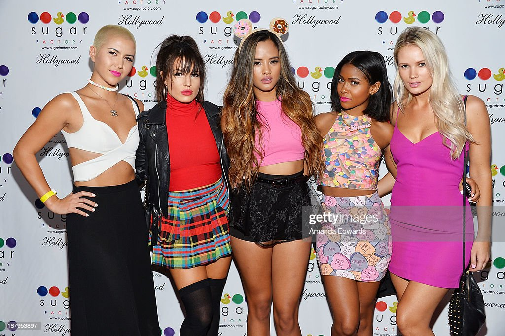 Singers Paula Van Oppen, Natasha Slayton, Emmalyn Estrada, Simone Battle and Lauren Bennett of the band G.R.L. arrive at the grand opening of Sugar Factory Hollywood at Sugar Factory on November 13, 2013 in Hollywood, California.