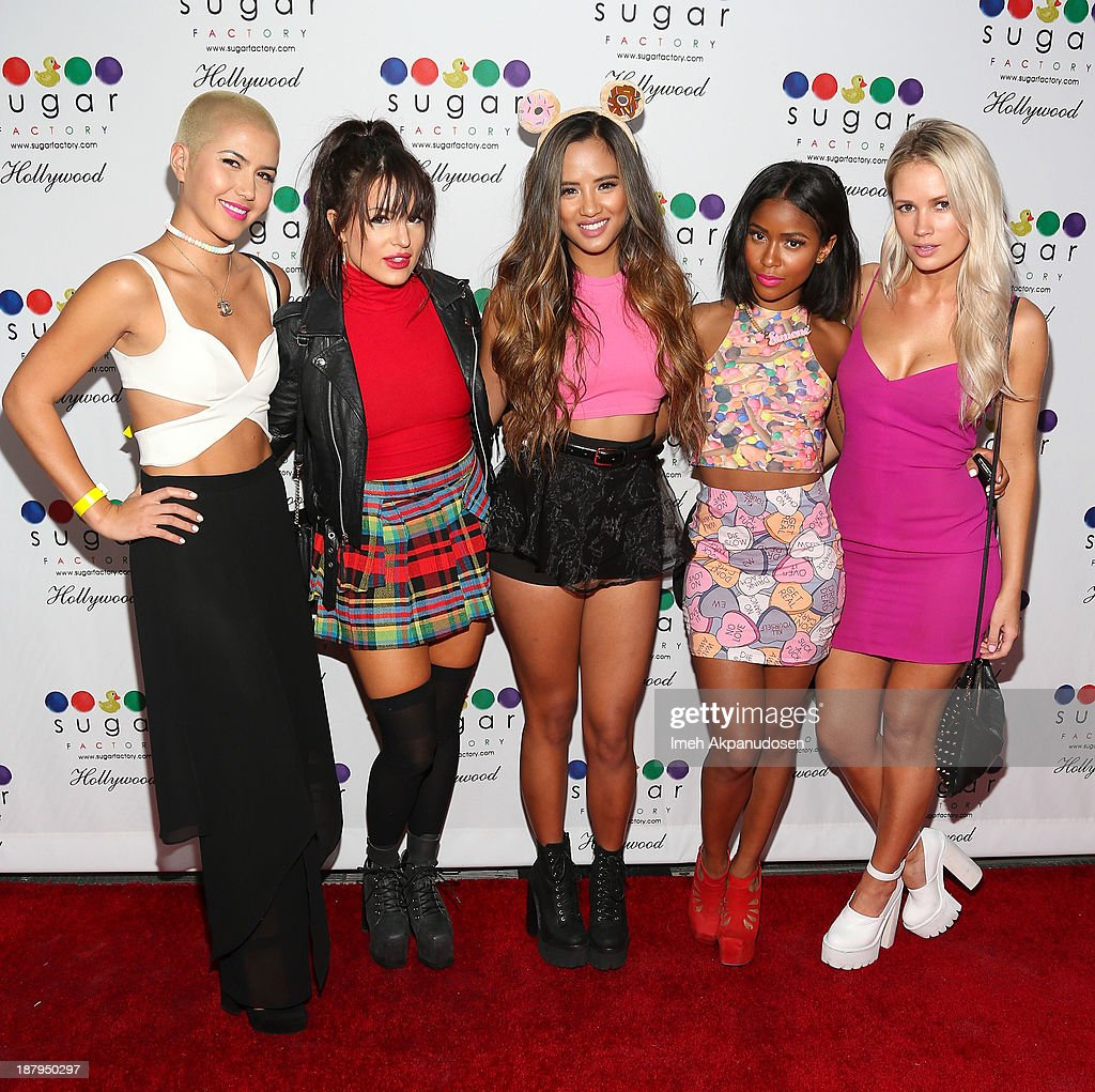 Singers Paula Van Oppen, Natasha Slayton, <a gi-track='captionPersonalityLinkClicked' href=/galleries/search?phrase=Lauren+Bennett&family=editorial&specificpeople=2242449 ng-click='$event.stopPropagation()'>Lauren Bennett</a>, <a gi-track='captionPersonalityLinkClicked' href=/galleries/search?phrase=Simone+Battle&family=editorial&specificpeople=5698917 ng-click='$event.stopPropagation()'>Simone Battle</a>, and Emmalyn Estrada of G.R.L. attend the Sugar Factory Hollywood grand opening at Sugar Factory on November 13, 2013 in Hollywood, California.