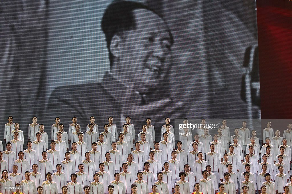 Singers perform during a gala show to celebrate the 90th anniversary of the founding of the Communist Party of China (CPC) in the Great Hall of the People on June 28, 2011 in Beijing, China. This year's celebrations will mark the 90th anniversary of the founding of the CPC.