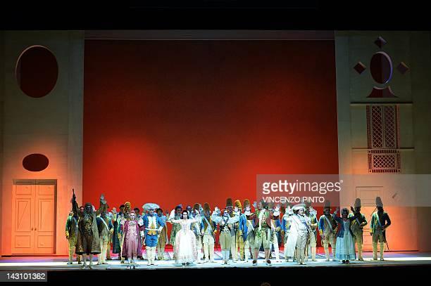 Singers perform during the dress rehearsal of Gioacchino Rossini's opera ' Il Barbiere di Siviglia ' at the Opera Theatre in Rome on April 17 2012...