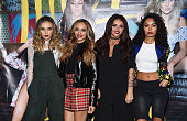 Singers Perrie Edwards Jade Thirlwall Jesy Nelson and LeighAnne Pinnock of the girl band Little Mix pose before performing onstage and signing copies...
