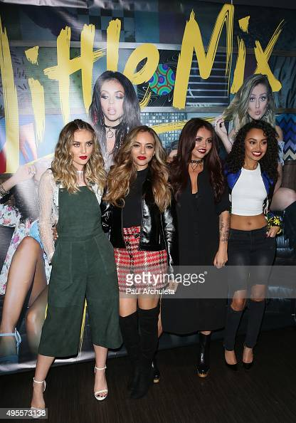 Singers Perrie Edwards Jade Thirlwall Jesy Nelson and LeighAnne Pinnock of the Girl Group Little Mix performs live at the Hard Rock Cafe on November...